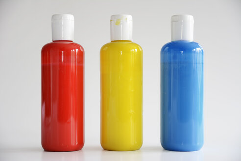 Red, Yellow, Blue bottles on gray background - ONF000128