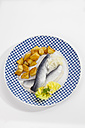 Herring with roasted potatoes and onions on plate, close up - CSF018783