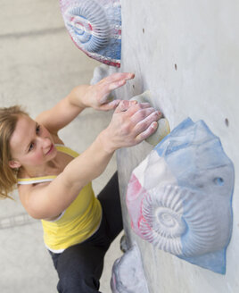Germany, Bavaria, Munich, Young woman bouldering - HSIYF000206