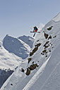 Austria, Man skiing on snowcapped mountains - FF001337
