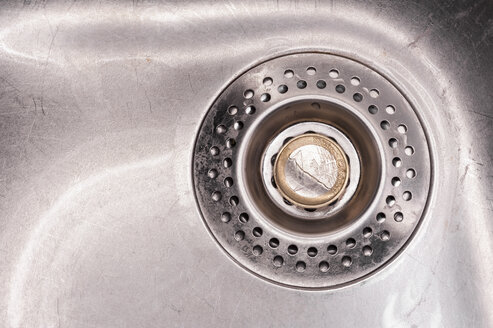 Euro coin in kitchen sink, close up - KJF000216