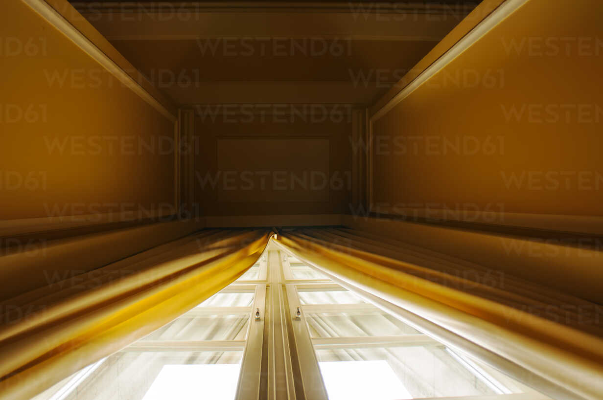 Germany, Berlin, Yellow curtains on high window - FB000036 - Frank Blum/Westend61