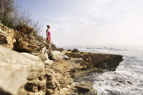 USA, Hawaii, Woman standing by shore - SKF001263