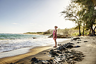 USA, Hawaii, Mid adult woman standing on beach - SKF001288