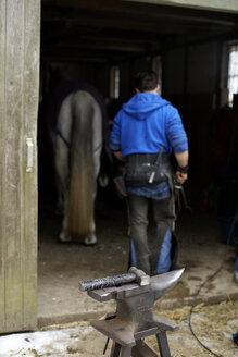 Germany, Mature man in hut - TK000112