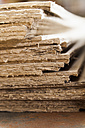 Germany, Bavaria, Stack of deckle edge paper for printing copperplate at print shop - TC003428
