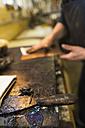 Germany, Bavaria, Mature man working in print shop - TC003434