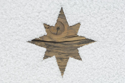 Carved christmas star on wooden board - AS004918