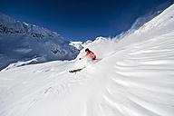 Austria, Salzburg, Young man skiing in mountain of Altenmarkt Zauchensee - HHF004568