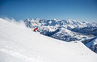Austria, Salzburg, Young man skiing in mountain of Altenmarkt Zauchensee - HHF004566