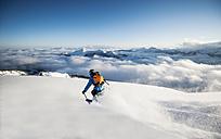 Austria, Salzburg, Mid adult man skiing in mountain of Altenmarkt Zauchensee - HHF004564
