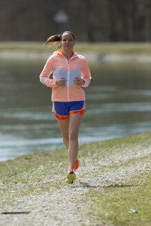 Gremany, Bavaria, Munich, Mid adult woman running - FF001342