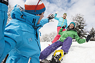 Austria, Salzburg, Young women and man having fun in snow at Altenmarkt Zauchensee - HHF004558