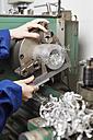 Germany, Kaufbeuren, Woman working in manufacturing industry - DSC000077