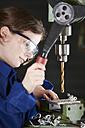 Germany, Kaufbeuren, Woman working in manufacturing industry - DSC000074