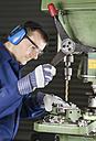 Germany, Kaufbeuren, Man working in manufacturing industry - CA000005