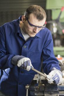Germany, Kaufbeuren, Man working in manufacturing industry - CA000003