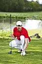 Germany, Bavaria, Mature man on golf course - MAEF006652