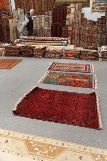 Turkey, Man holding Desen Halicilik Carpet - SIE003719