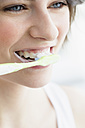 Germany, Bavaria, Munich, Young woman brushing teeth, close up - SPOF000403