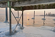 Germany, Jetty and mooring post with ice formation in Lake Constance - SH000663