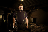 Portrait of blacksmith in his workshop - CNF000068