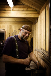 Portrait of smiling craftsman in his workshop - CNF000072