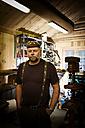 Portrait of craftsman in his workshop - CNF000074