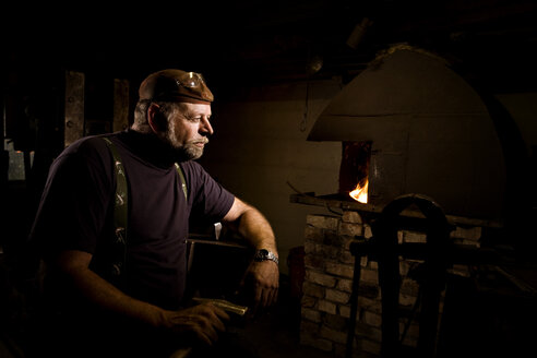 Blacksmith in workshop lost in thought - CNF000078