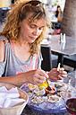 USA, Florida, Miami, Mature woman eating fresh raw oysters, close up - ABA000863