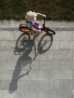 Austria, Girl cycling on street - CWF000053
