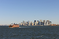 USA, New York State, New York City, View of Lower Manhattan with ferry on Hudson river - RUEF001028