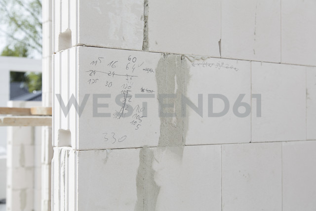 Germany, Brandenburg, Wall of gas concrete blocks at construction site - FK000184