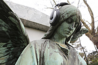 Germany, Cologne, Angel statue with headphones in cemetery - JAT000060