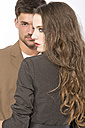 Young couple against white background, close up - MAEF006782
