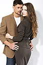 Young couple against white background, close up - MAEF006786