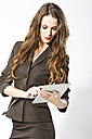 Businesswoman using digital tablet, close up - MAEF006793