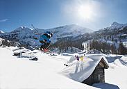 Austria, Salzburg, Young man ski jumping in mountains - HH004632