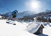 Austria, Salzburg, Young man ski jumping in mountains - HH004634