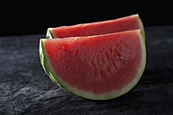 Slices of watermelon on textile, close up - CSF019332