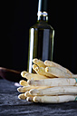 Bunch of white asparagus with bottle of white wine, close up - CSF019317