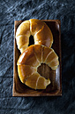 Butter croissants on wooden tray, close up - CSF019319