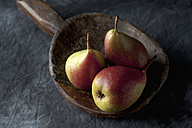 Pears on wooden spoon, close up - CSF019376