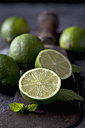 Limes with leaves and sickle, close up - CSF019346