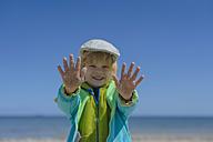 Germany, Mecklenburg Western Pomerania, Boy playing with sand at baltic sea - MJF000172