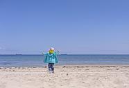 Germany, Mecklenburg Western Pomerania, Boy playing with sand at baltic sea - MJF000187