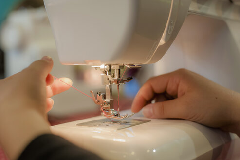 Germany, Saxony, Person working on sewing machine - MJ000204