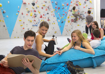 Friends relaxing together, indoor climbing - HSIYF000240