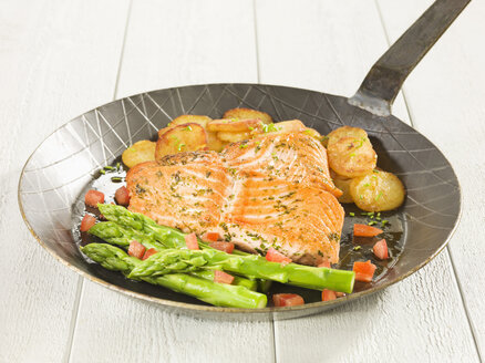 Marinated salmon with vegetables on frying pan - CHF000043