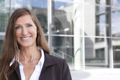 Germany, Berlin, Portrait of businesswoman, smiling - FKIF000032